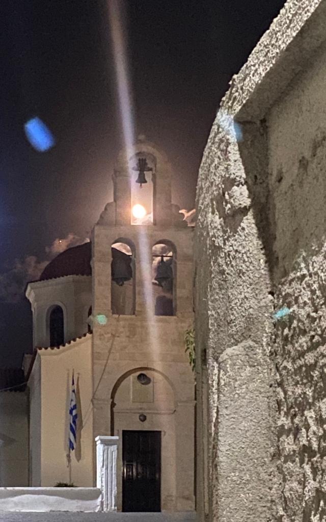 The moon shining through the church